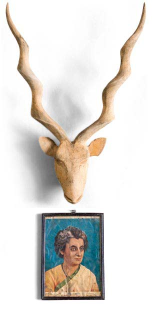 carved antelope head on wall