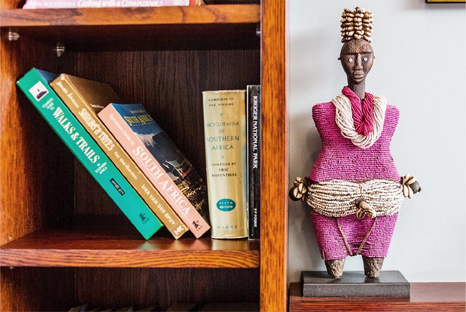 african sculpture next to books