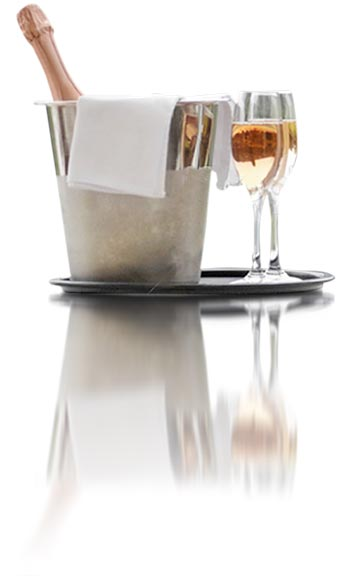 Champagne in bucket with two poured glasses