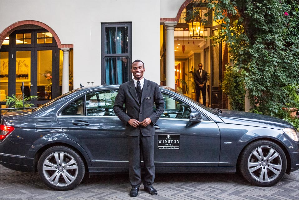 The Winston Hotel driver waiting in front of his Mercedes